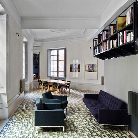Slideshow of Barcelona apartments with decorative floor tiles exposed during renovation from the Dezeen archives.