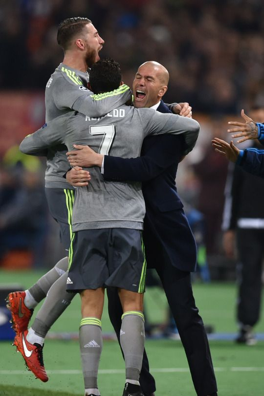 Cristiano Ronaldo celebrates with Sergio Ramos and Zinedine Zidane after scoring during the UEFA Champions League football match AS Roma vs Real Madrid