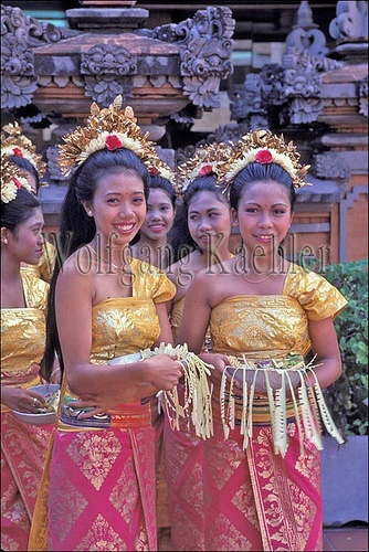 Balinese girls in traditional dress, ready to perform a welcome ceremony dance