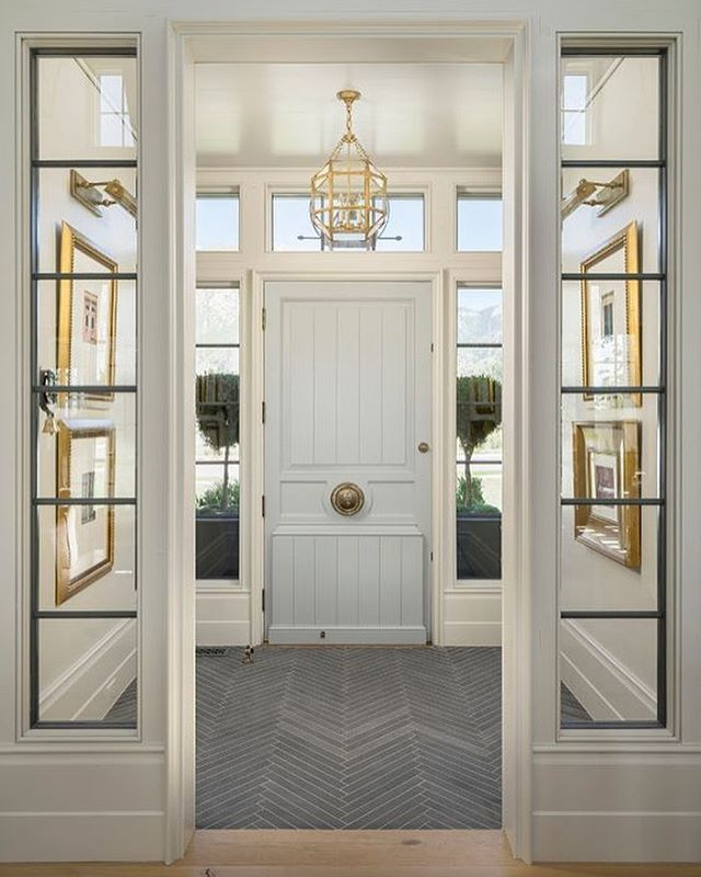 "Notice anything unusually fabulous about this foyer designed by Elizabeth Kimberly @Establish.Design? I'll accept ""everything"" for an answer, but truly - those slate tiles installed in a herringbone pattern, where you might otherwise expect the hardwood flooring to carry through - is an awesome design detail! #getinspired"