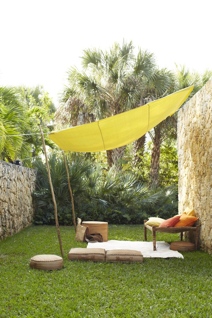 Drop Cloth Canopy | Martha Stewart. Could we treat painting drop cloths for weather (and maybe dye them too) for a patio canopy?