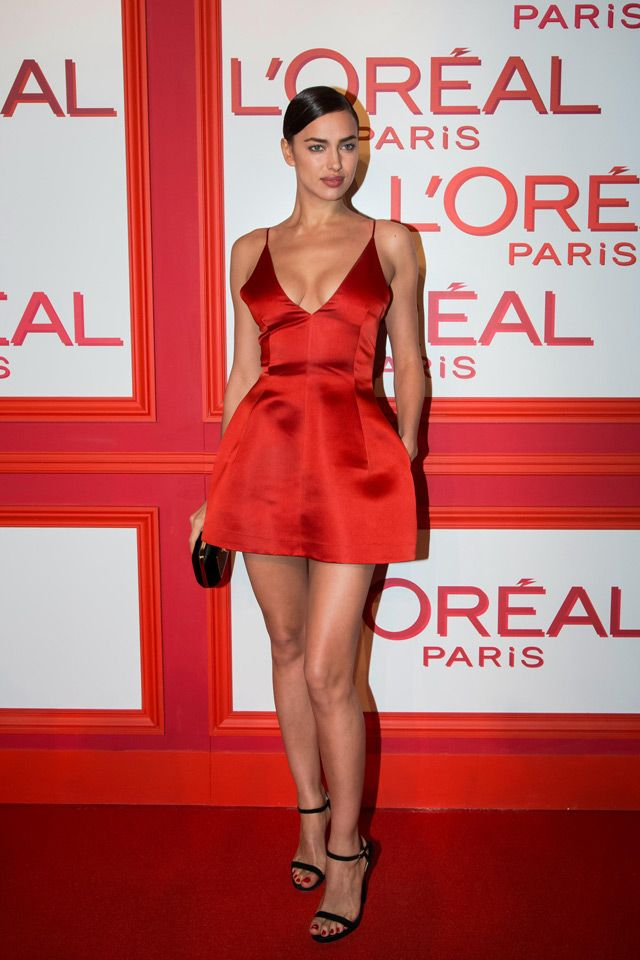 Irina Shayk poses for photographers upon arrival at the L'Oreal Red Obsession Party in Paris.