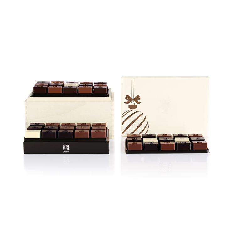 Treat someone special to a scrumptious holiday surprise with this natural basswood box filled to the brim with 45 delectable chocolates created by World Champion French Chocolatier Pascal Caffet. [USD 126.27] Discover our Holiday Zenith: http://www.zchocolat.com/shop/en/holiday-collection/344-holiday-zenith.html