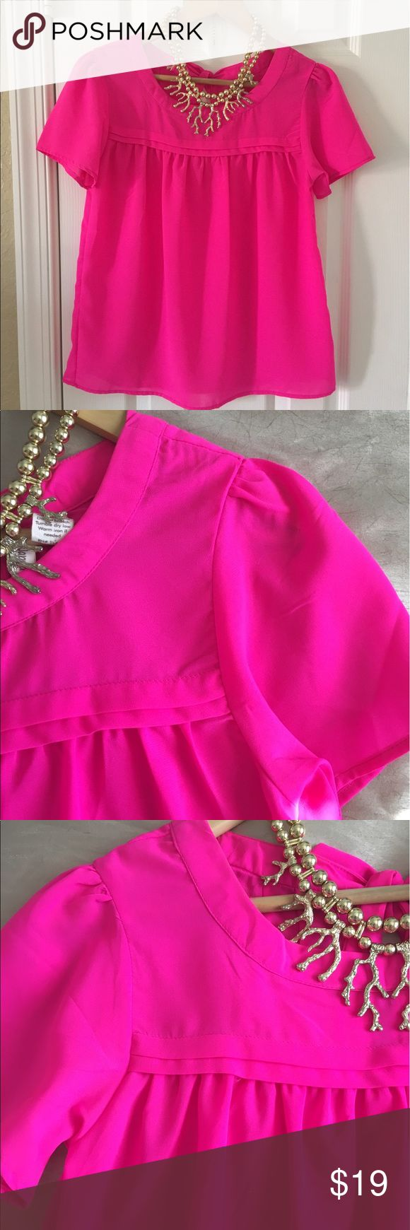 Hot Pink Blouse Adorable Pink Blouse with slight puff Sleeve. So cute! Great color, slightly sheer. Dress up or dress down. Sat in closet, Excellent Condition! Tops Blouses