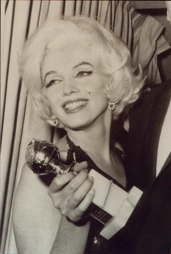 Marilyn with her Golden Globe, 1962
