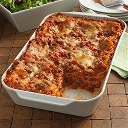 Cheesy Beef Lasagna  Uncooked Noodles!!  Hearty lasagna recipe with a ground beef meat sauce and three cheeses layered with uncooked lasagna noodles to save some work.