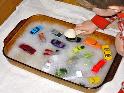 A toy car wash to keep the kids busy. Use tooth brushes?  So fun and easy!