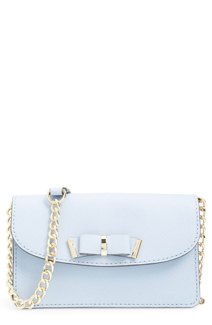 The gorgeous goldtone hardware and a prim bow add such cute sophistication to this pale blue Michael Kors crossbody bag.
