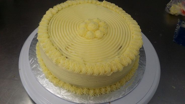 Yummy lemon cake with lemon cream cheese frosting. Decorated by Coast Cakes Ltd