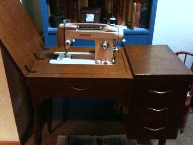 Fun 1950s White model 763 sewing machine in cabinet. This is a ...
