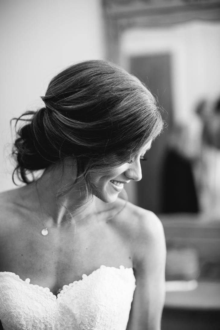 Show off your shoulders with a loose wedding up-do of loose curls tied back into a bun.
