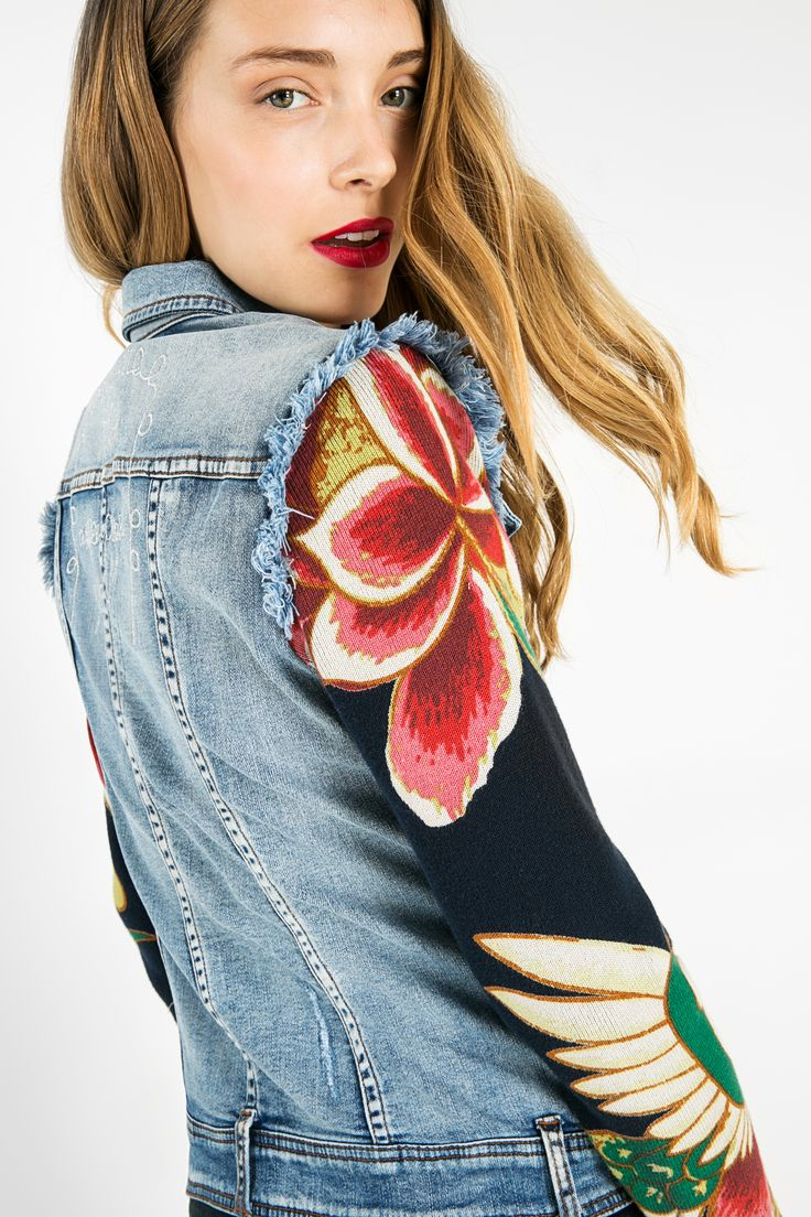 Have you noticed the drawings on the sleeves? This denim jacket makes dreams come true. Ok, we are overreacting a bit, but we love how well denim matches these prints. And wait til the model turns around, because the details in the pockets are overwhelming. Yes, we are excited.