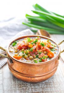 Get the New Year started on the right track with this healthy Lentil Soup! It's an easy dinner that can be made in the slow cooker or on the stovetop!