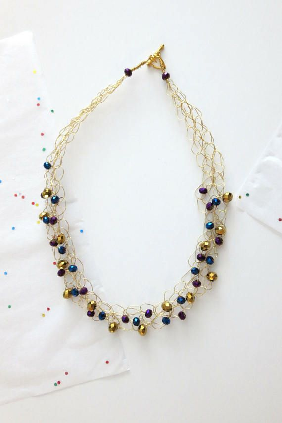 This dazzling statement necklace is the perfect accessory to add a little sparkle to your outfit! #gold #jewelry #sparkles