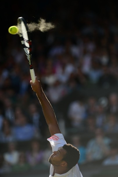 France's Jo-Wilfried Tsonga serves during his men's singles semi-final match against Britain's Andy Murray on day 11 of the 2012 Wimbledon Championships on July 6, 2012.