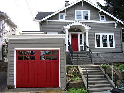 grey house, white trim, red doors
