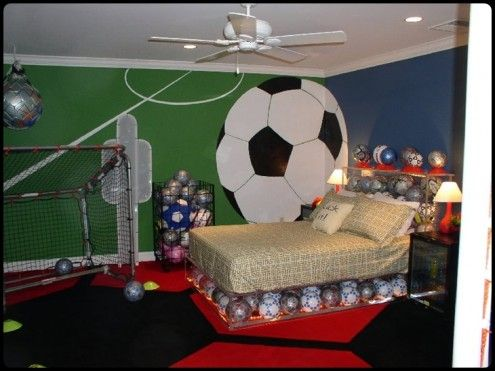 Calvin's room! Love the giant soccer ball on the wall, and the bed frame made out of soccer balls!!!!