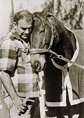 John Henry and his groom, Jose Mercado. 1986 Eclipse Award for outstanding equine photography. January 28, 1987