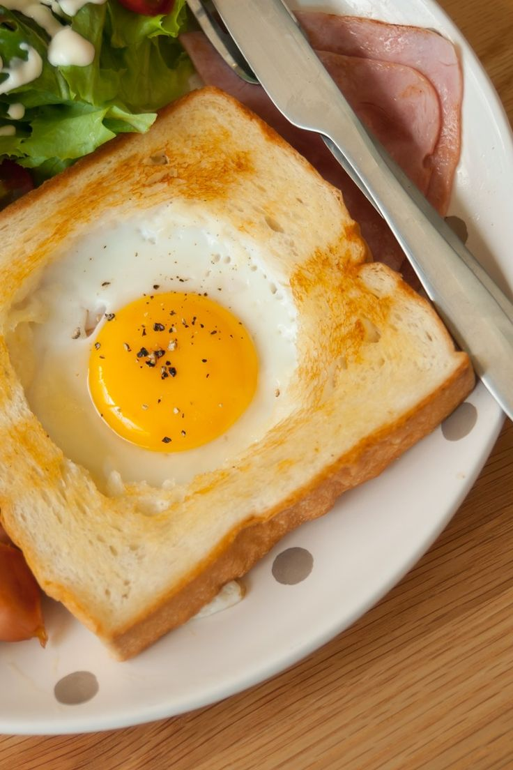 Egg in a Hole Recipe - buttery toasted bread with a fried egg in the center.