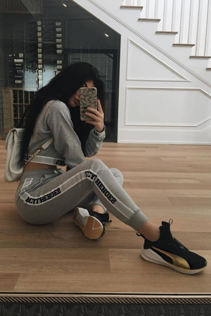 Kylie Jenner wearing Chanel Vintage Backpack, Kimoji Kylie Case, Puma Fierce Gold Training Shoes, Local Heroes Grey Cropped Hoodie and Local Heroes Grey Striped Sweatpants