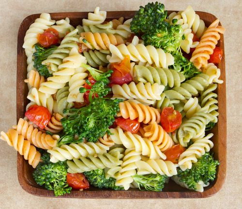 Picnic Party Pasta Salad - With broccoli, tomatoes, dried red onion, parsley, and basil.