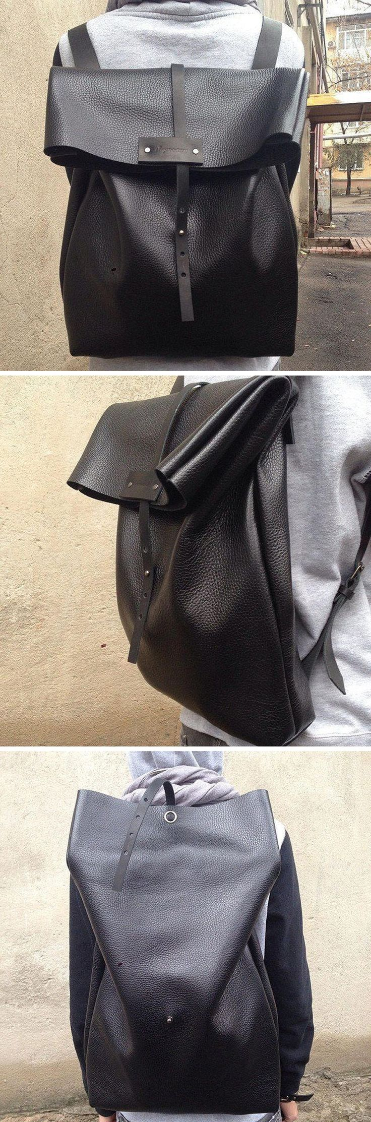 This oversized black leather backpack is handmade and modern in design. The adjustable closing strap allows the bag to evolve to an even larger bag.