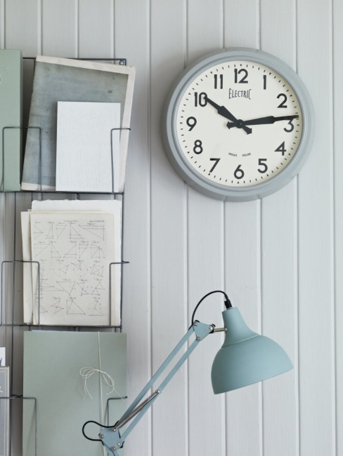 Retro clock and wire wall filing in soft shades of duck egg and eau de nil