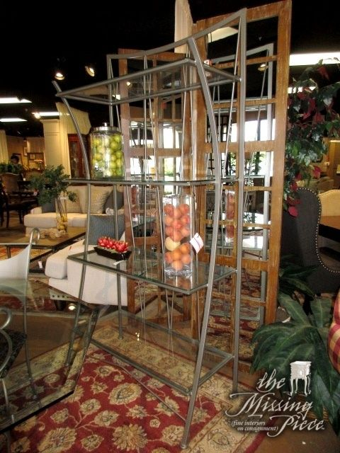 """Contemporary metal bakers rack in silver with four glass shelves. Could be used in a dining room or as a display piece in a living room. 40""""wide x 17""""deep x 79""""high."""