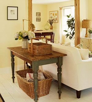 rustic table and basket behind sofa