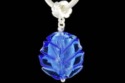 blue glass, leaf shape, with silver foil. Lenght mm. 25.