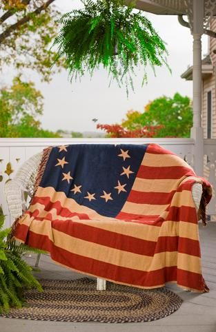 Old Glory Throw Woven 50 x 60 from Victorian Heart (VHCBrands). The patriotic Old Glory Throw is made using a jacquard weave. The throw is 50 x 60 100% cotton with a flag featuring a star circle motif. This throw has the same image on the back with reversed colors and finished with tassels on both e