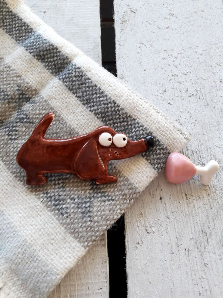 Two ceramic brooches Dog and Ham Brooches Dog shaped by Lamabo