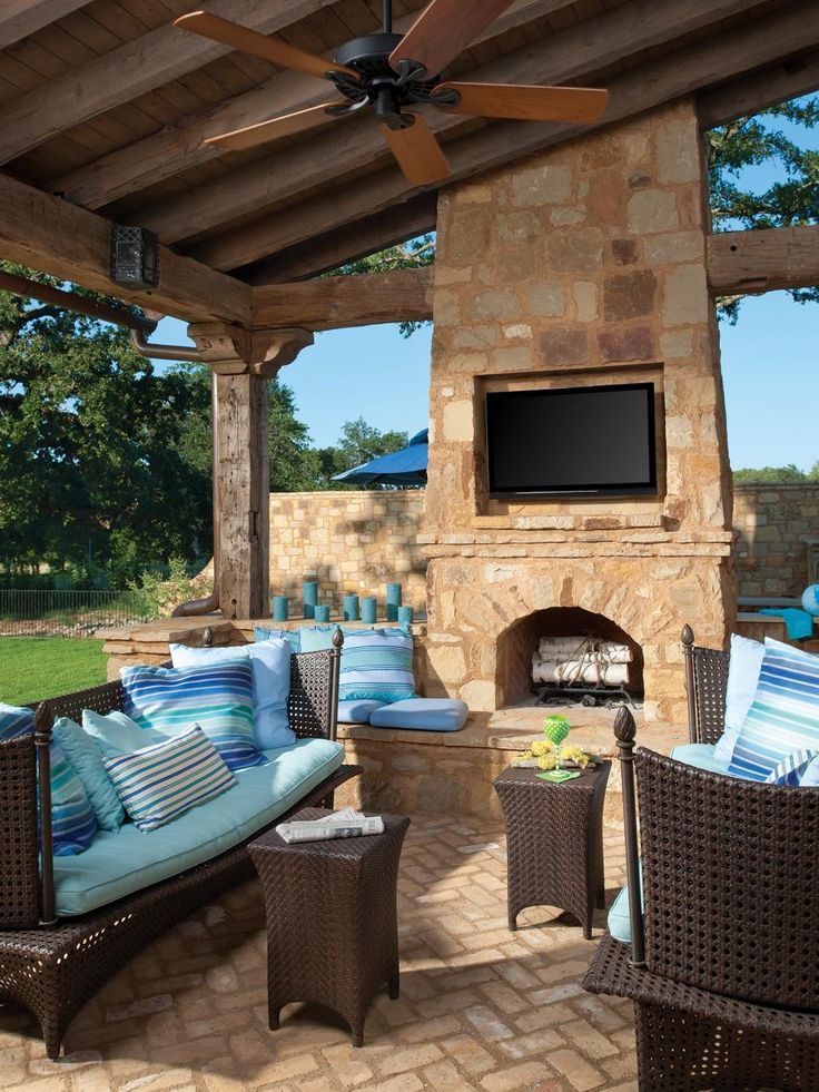 This Outdoor Room Takes A Fashionable Turn With Bright Blue Cushions And  Pillows. A Rustic