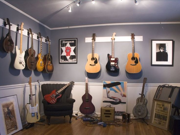 hang all of johns guitars in the spare bedroom guitar room