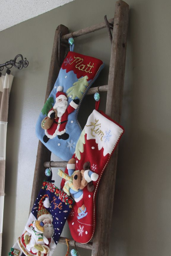 credit: A Spotted Pony [http://aspottedpony.com/home-decor/an-alternative-to-putting-christmas-stockings-on-a-mantel-rustic-antique-ladder-stocking-hanger/2028/]