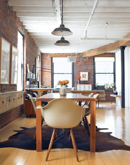 Eames chairs in a rustic kitchen