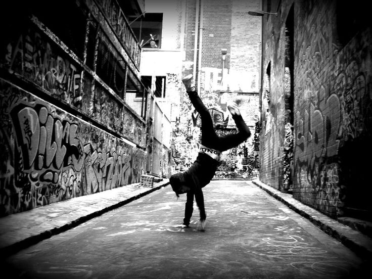 1975 | DJ Kool Herc coins the term break-boy to describe dancers that would dance during his extended breaks in the music. Soon, the term is shortened to b-boy and the style is called 'breakdancing.' Herc also takes an up-and-coming DJ named Grandmaster Flash under his wings.