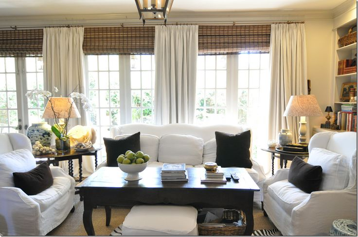 Linen curtains bamboo shades drapes pinterest roman shades window and white family rooms for Bamboo shades in living room