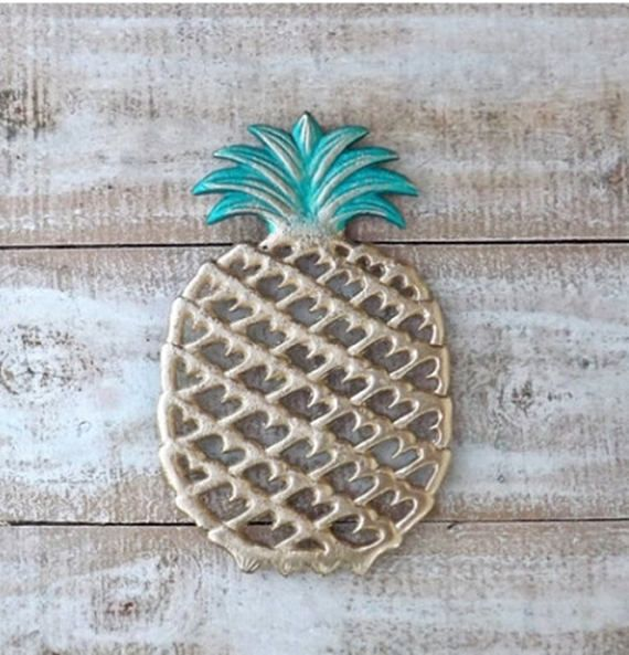 Sturdy Cast Iron Pineapple Trivet... The perfect fit for your farmhouse kitchen cook!! I have refinished this one in gold with a metallic green top Dimensions: Length: 9 5/8 Width: 6