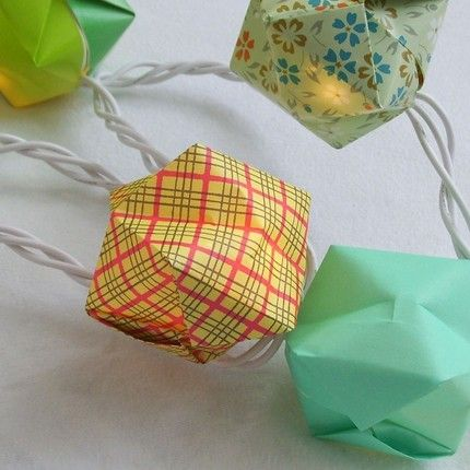 Origami balloon lanterns that fit right over LED Christmas lights! So cute, and would make a summer wedding unique