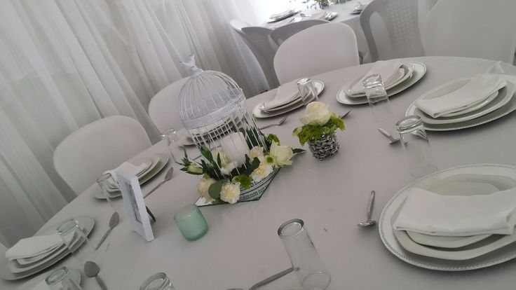 I chose white bird cages with flowers for the centerpieces. With mint green candles and a personal favorite was the picture of my nephew in the white frame on each table. Classic, simple and yet so elegant.
