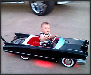 custom cadillac baby strollerpush car from todd rodz im not sure about the flames that shoot out of the back but what kid wouldnt love riding