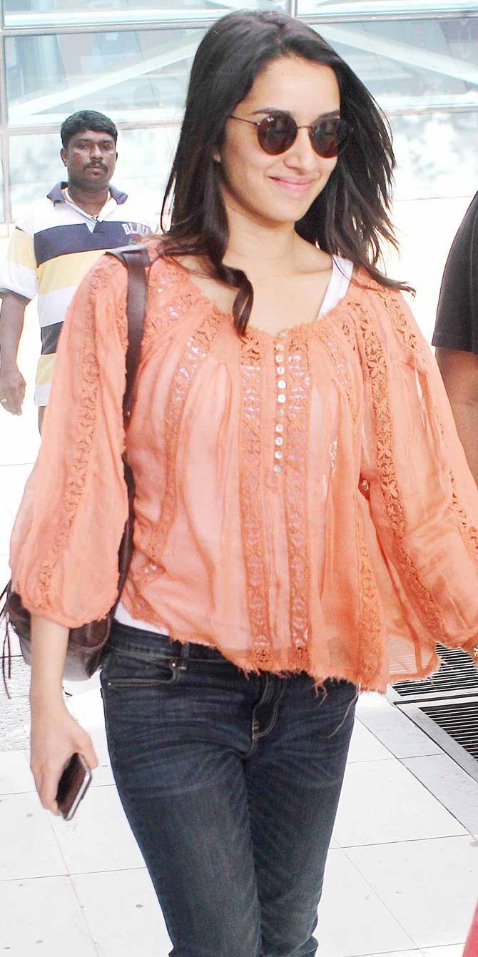 Shraddha Kapoor smiling at the shutterbugs at the Mumbai airport. #Bollywood #Fashion #Style #Beauty