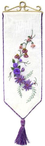 """Floral Fantasy - #2633 This advanced Brazilian embroidery project is stitched on raw silk fabric. It fits 12 cm (about 4½"""") bell pull hardware or could be framed. Double cast-on flowers, raffia roses, and the original, new quad drizzle flowers combine to challenge the stitcher. Directions for creating raffia thread are included, as well as instructions for the twisted cord edging and tassel. $12.00"""