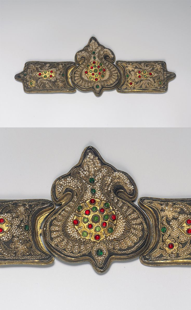 Late-Ottoman belt buckle, from Turkey, ca. 18th century.  Gilt-metal and silver, decorated with silver-gilt thread, seed pearls and gemstones.