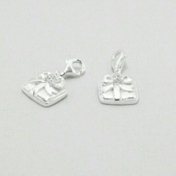IN STOCK! 925 Sterling Silver XMAS Present Charms LIKE THIS LISITING TO BE NOTIFIED IF THE PRICE DROPS! NWT 925 Sterling Silver Christmas Present Charms. 4 available! Cute silver gift boxes with bows. Center of bow features CZ accent. Convenient lobster claw clasps allow you to wear these darling charms with any other item in your collection. BRAND NEW, comes in original packaging. Feel free to ask any questions. PRICED TO SELL! Bundle for further discounts. Boutique  Jewelry