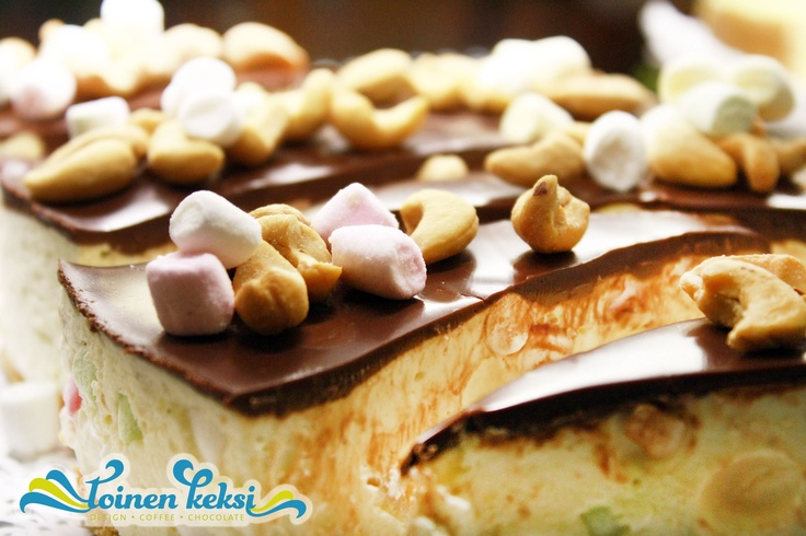 Chocolate covered cheesecake with salted nuts and marshmallows