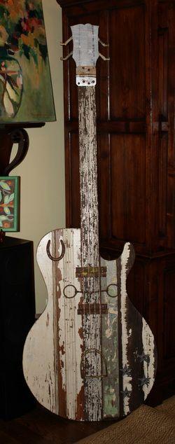 Wooden guitars... great artwork!  folk art  by ridley stallings www.ridleystallingsart.com