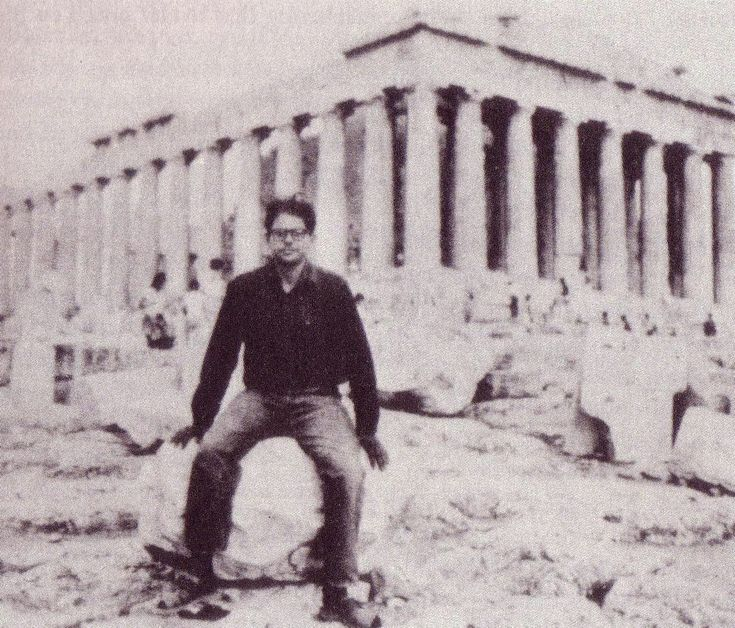 """Allen Ginsberg at the Acropolis, August 30, 1961. """"Acropolis like any Golgotha has blue eyesockets thru the columns the bright blue north a void for hair – and empty blue metafisks surround all the blocks of bright new marble ο α θ η ν α ι ο ν τ π η α ς Passengers seated on the steps of the huge slow moving bus that's standing still...""""From a letter to his father Louis as included in Family Business: Selected Letters Between a Father and his Son, Allen and Louis Ginsberg,"""