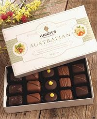 Haigh's Chocolates • Australian chocolate collection decorated with fresh wattle flowers • Adelaide city icon